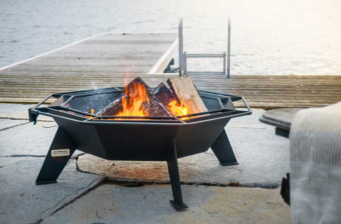 Octagonal Cottager fire put on lake edge