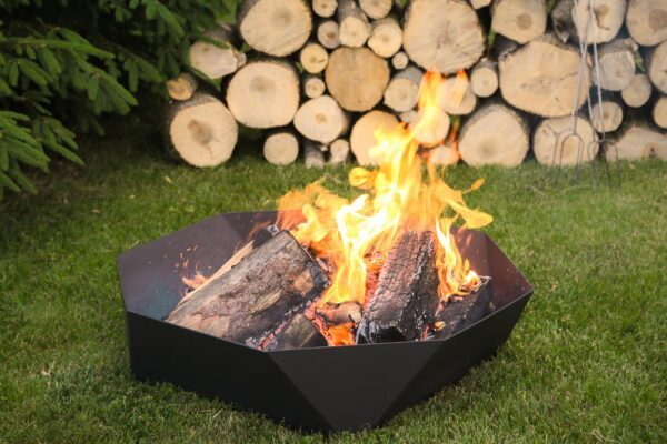 """The 30"""" Cupola Fire Ring being used in a backyard"""