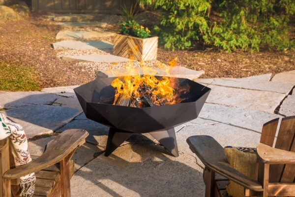 a large polygon shaped fire pit containing a large outdoor fire