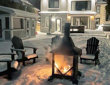 Chiminea in backyard in winter