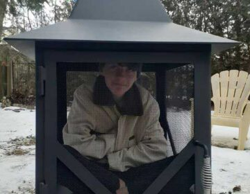 Person sitting inside Chiminea