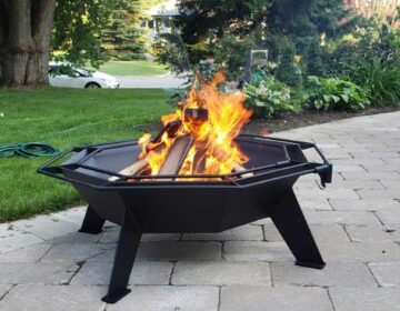 Lit Cottager fire pit on patio