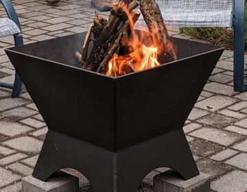 Modern Cube Fire Pit on patio, fire burning.