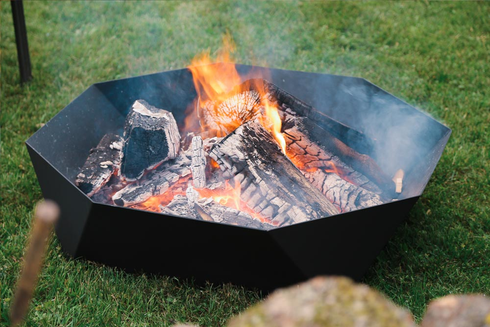 Cupola Fire Pit, sitting on lawn. Fire burning.