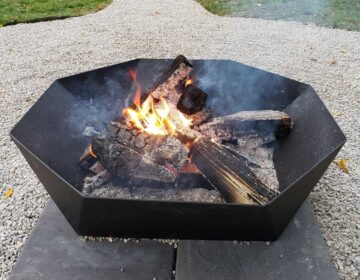 Cupola Fire Pit, lit, on backyard patio