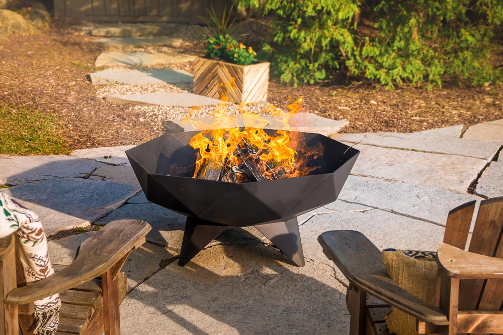 burning Polygon Bowl fire pit on patio