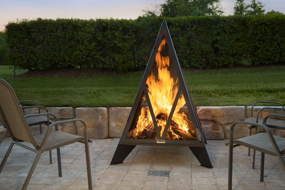 Lit Pyramid outdoor fireplace on patio